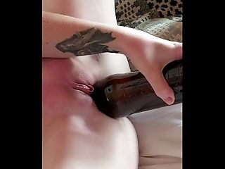 Wife playing with a bottle