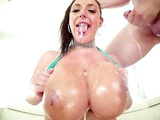 Mega busty hoochie Angela White plays with her huge boobs and big oiled up dick