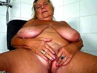 Mature white BBW lady with enormous breasts masturbates in the chair