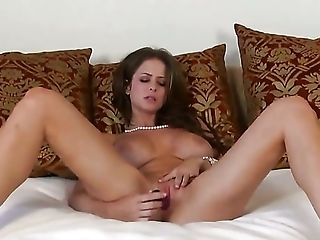 Emily Addison with giant boobs and smooth cunt spends time dildoing her fuck hole for camera