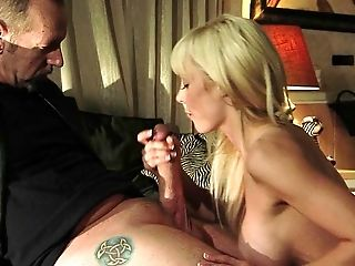 Warm cougar with fake tits giving huge dick blowjob while her pussy is pounded hardcore in mmf porn