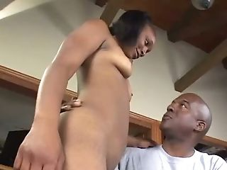 Chocolate nympho with sexy brown eyes Trixxie provides her stud with BJ