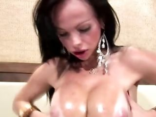 Hot Latina tranny in tropical dress oils up her large boobs