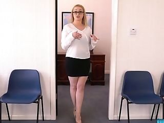 Mega busty secretary Rachael shows off her assets and dances