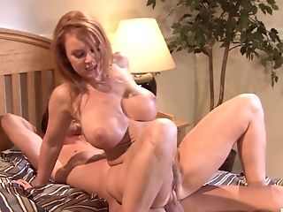 Fake tits wife Janet Mason spreads her legs and rides a large dick